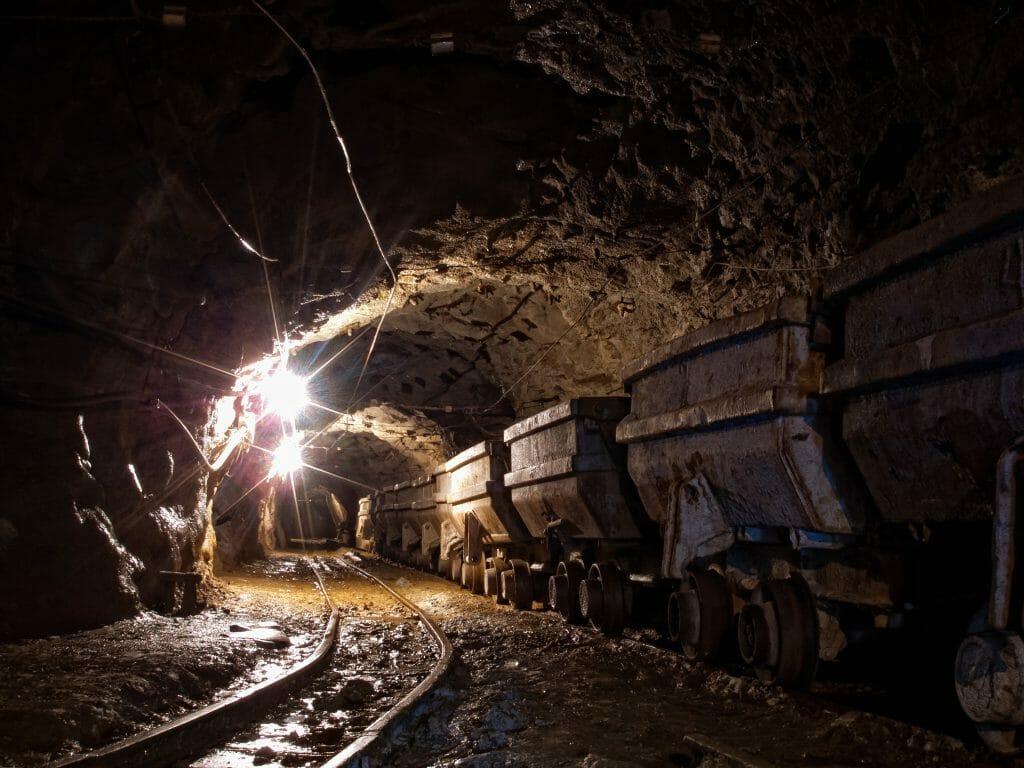 underground gold mine with trolleys mine carts